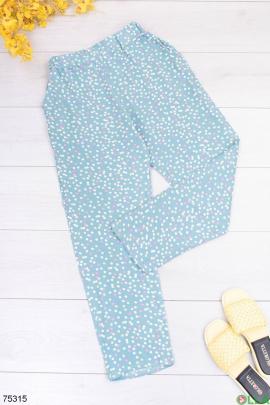 Женские бело-голубые брюки в горошек