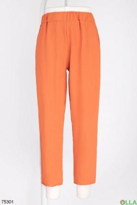 Женские оранжевые брюки