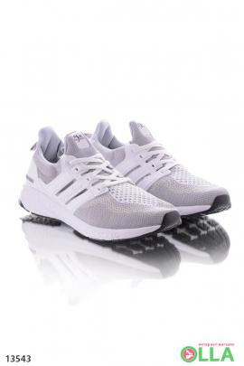 Серые с белым спортиыные кроссовки