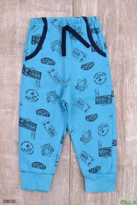 Голубые спортивные штаны с принтом