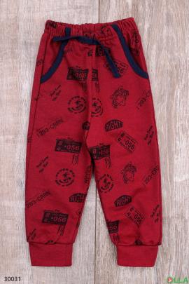 Бордовые спортивные штаны с принтом
