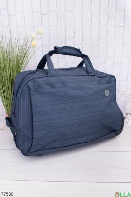 Синяя дорожная сумка
