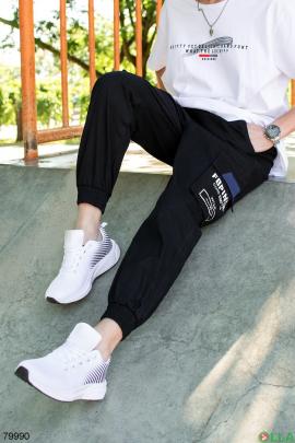 Мужские черные брюки с надписью