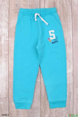 Спортивные штаны голубого цвета