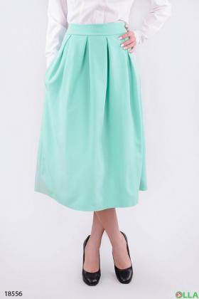 Стильная юбка-миди с карманами