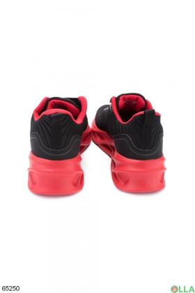 Мужские черные кроссовки с красной подошвой