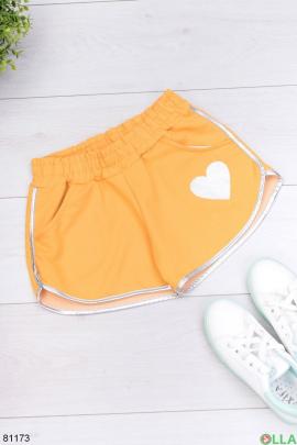 Женские оранжевые спортивные шорты