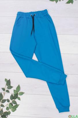Женские спортивные брюки голубого цвета