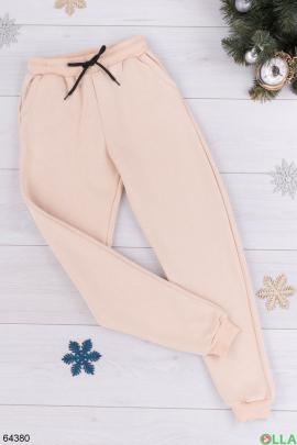 Женские бежевые спортивные брюки на флисе