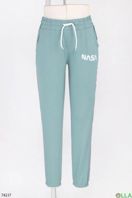Женские спортивные бирюзовые брюки с лампасами