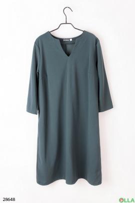 Женское платье зелёного цвета.