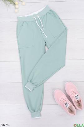 Женские бирюзовые спортивные брюки