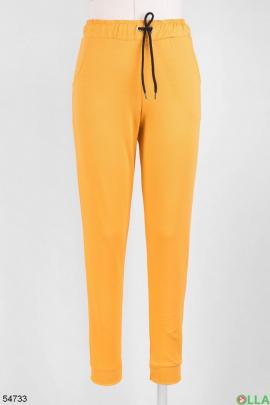 Женские оранжевые спортивные брюки