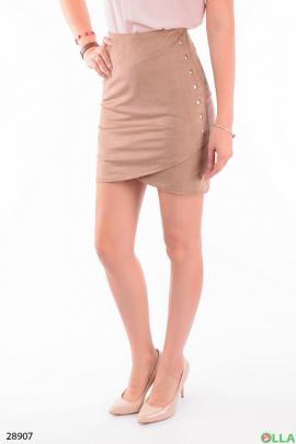 Бежевая юбка с заклепками