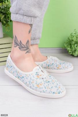 Женские белые кроссовки в принт