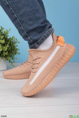 Женские оранжевые кроссовки на шнуровке