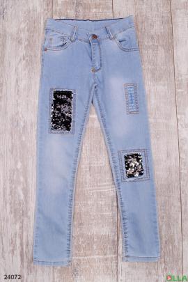 Стильные джинсы со вставками из пайеток