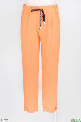 Женские спортивные оранжевые брюки