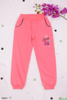 Спортивные штаны розового цвета