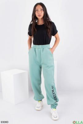 Женские зеленые спортивные брюки на флисе