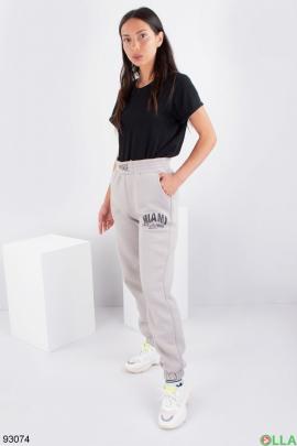 Женские светло-бежевые спортивные брюки на флисе