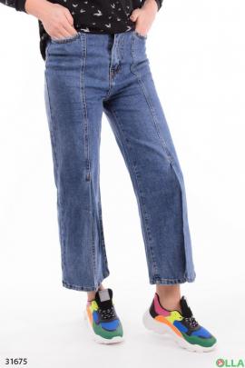 Широкие женские джинсы с разрезами