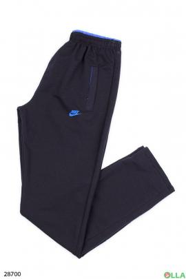 Спортивные штаны синего цвета