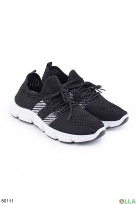 Женские черные кроссовки с белыми вставками