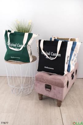 Женская бело-зеленая сумка с надписью
