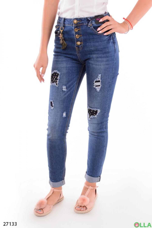 Женские джинсы с порванностями