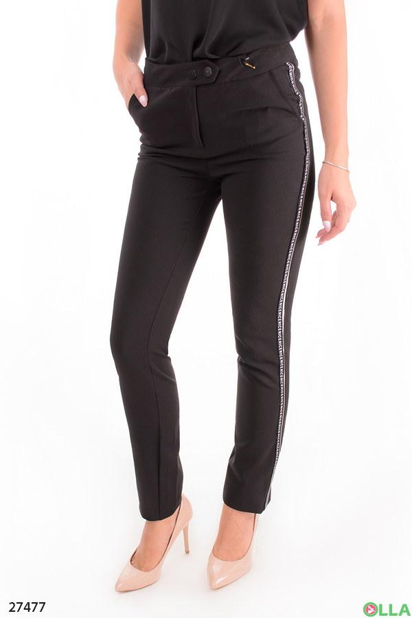 Женские брюки черного цвета с лампасами